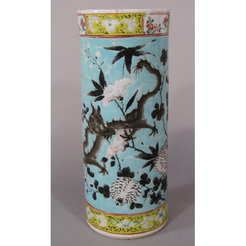 59 - A 19th century oriental vase of cylindrical form with polychrome painted dragon and flowering tree d...