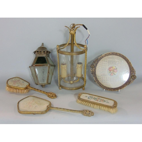 615 - A collection of mixed metalware to include a twin branch hanging cylindrical glass lantern,a further...