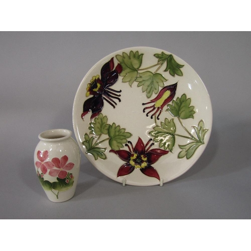9 - A cream ground Moorcroft plate in the Columbine pattern with impressed and painted marks to base,25....
