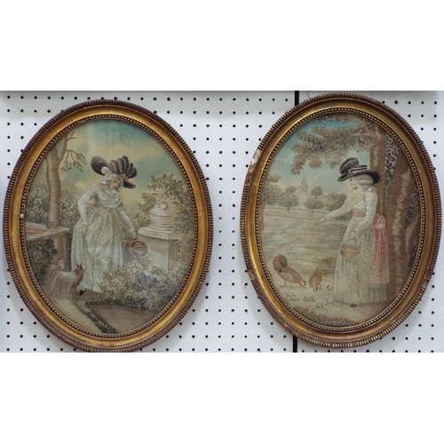 1612 - A pair of finely executed silk work embroidered pictures of oval form showing a pair of ladies in la...