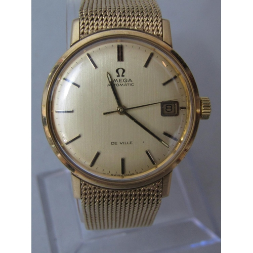 563 - Vintage Omega Automatic De Ville 9ct wristwatch, gilt dial with date aperture and baton markers, 34m...