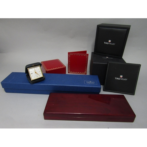 566 - A collection of watch boxes to include Cartier and Tag Heuer, with a Looping travel clock (5)...