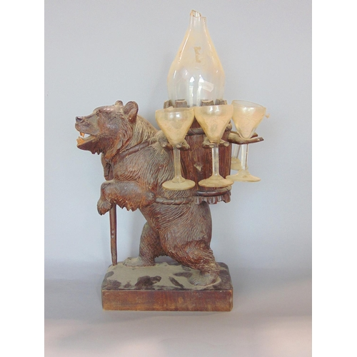 720 - Good quality carved Black Forest bear decanter set, the bear stood on his hind legs holding a walkin...