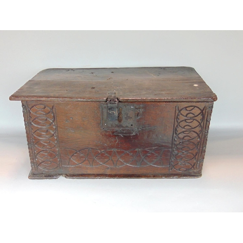 718 - Antique (possibly early 18th century) provincial oak coffer Bach type box, the front with carved arc...
