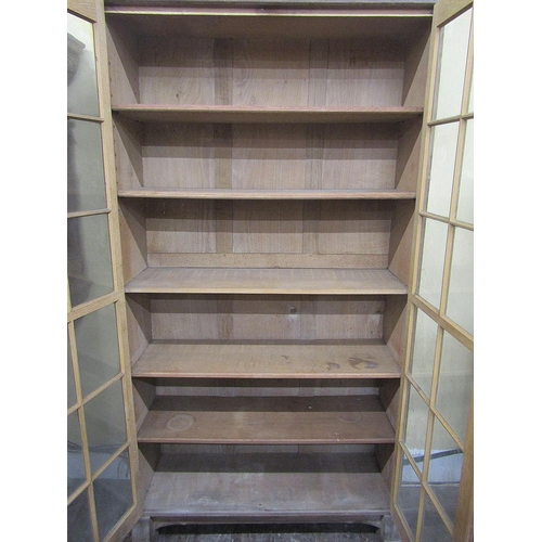 1516 - A Cotswold School oak bookcase with exposed dovetail and through tenon jointed construction enclosed...