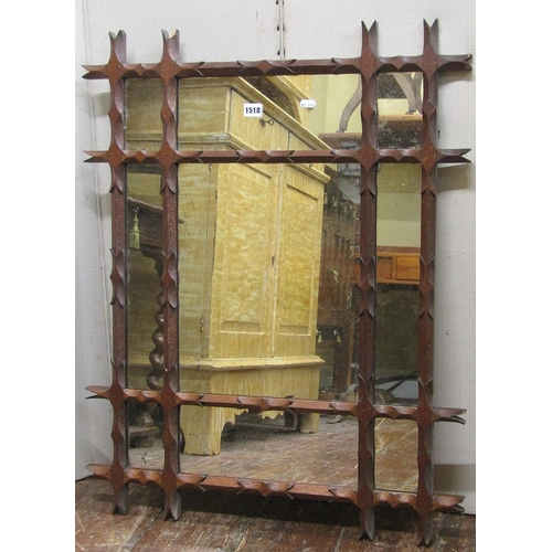 1518 - An Arts & Crafts style rectangular wall mirror with Oxford frame and carved detail, 70 cm x 88 cm...