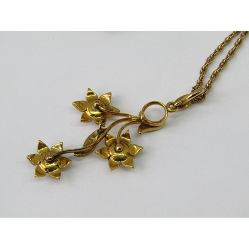 427 - Antique 9ct floral spray pendant set with seed pearls, hung on a 9ct rope twist chain and a similar ...