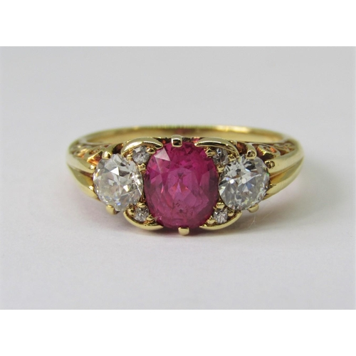 428 - Fine 18ct pink sapphire and diamond ring, London 1994, the sapphire 7 x 5mm approx, flanked by a pai...