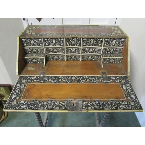 1527 - An 18th century Vizagapatam table bureau in sandalwood and ebony with trailing ivory and penwork flo...