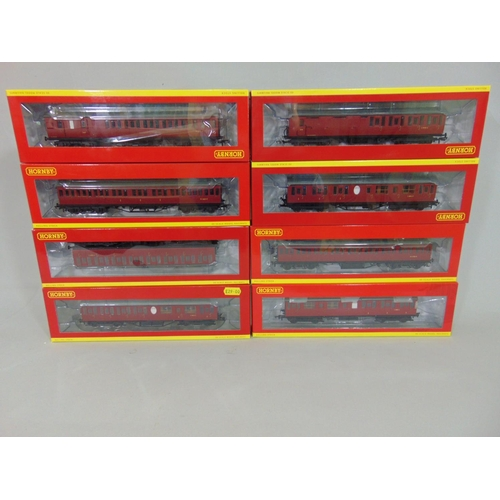 29 - 8 boxed Hornby BR coaches all in maroon livery, all with original packaging (8)...
