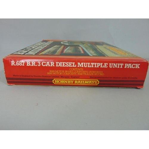 30 - 2 boxed sets of Hornby coaches: R2578 BR class 101 3 car pack and R687 BR 3 car diesel pack which in...
