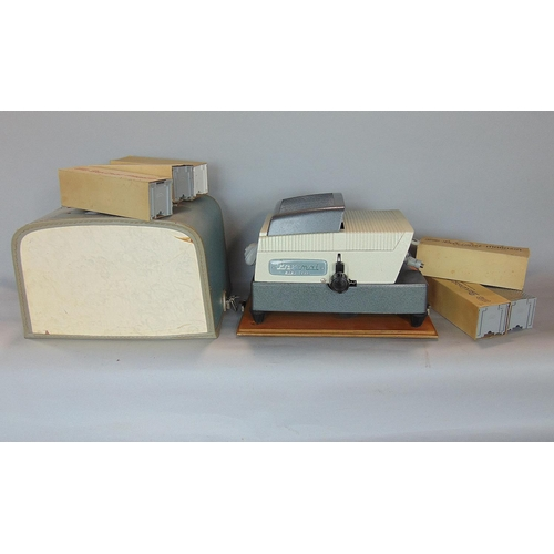 A brown Paximat Slide Projector (c 1950s/60s) complete with slide magazines & case, and a Dolby plaque