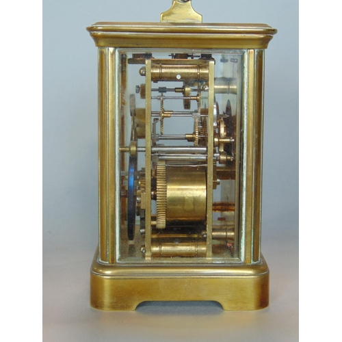 1177 - J W Benson carriage clock, the enamel dial with Roman and Arabic numerals, striking on a gong with t...