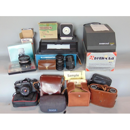 A collection of miscellaneous cameras including a Canon Ixus 1000 HS, a pair of Zeiss 8 x 30 binoculars, together with further Olympus and other cameras