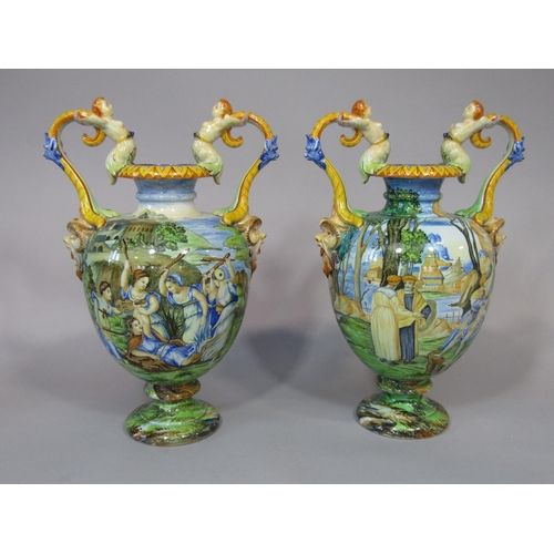 656 - A pair of large and good quality Italian Maiolica two handled vases by Ginori, both with all over po...