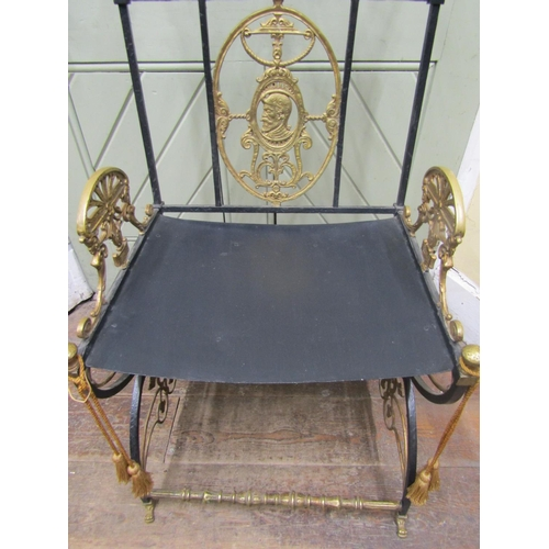 2055 - A decorative continental ironwork side chair with X shaped supports and brass rails, back panel and ...