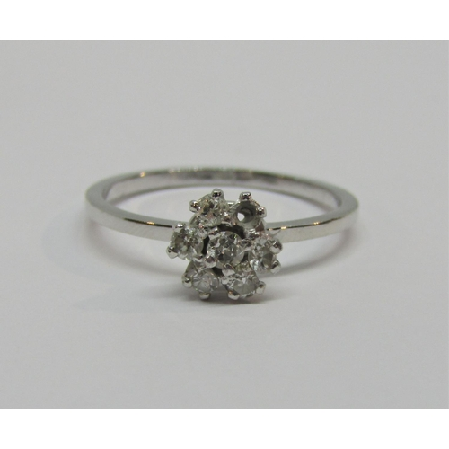 947 - Diamond cluster ring in unmarked white metal, size M/N, 2.1g (one stone vacant)...