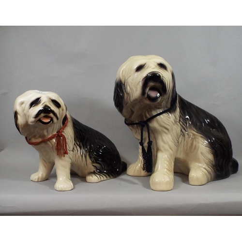 11 - Three pottery figures - Old English sheepdogs, all seated, two 36 cm in height, one 24 cm in height...