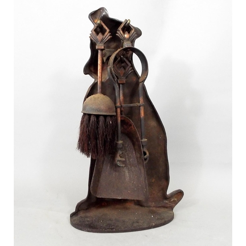 114 - A cast iron half side companion set in the form of a terrier supporting a selection of three small f...
