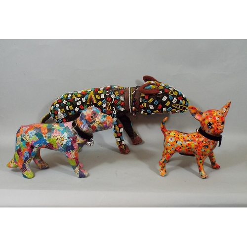 12 - Four highly decorative models of dogs, papier mache, timber and beadwork, decoupage finish, 35 cm in...