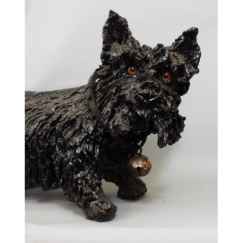 14 - A heavy pottery figure of a terrier with earlier leather collar and bell - in a black colourway, 31 ...