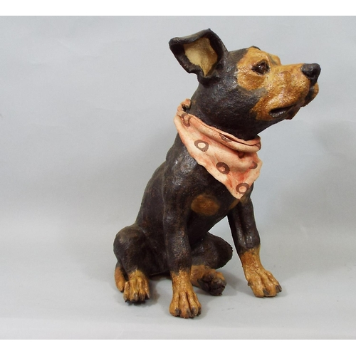 16 - Ceramic figure of a seated terrier with black and tan finish wearing a neckerchief, signed monogram ...