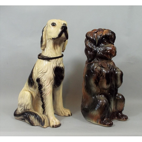 17 - A late Victorian terrier with glass eyes, in upright pose, together with a further pottery figure of...