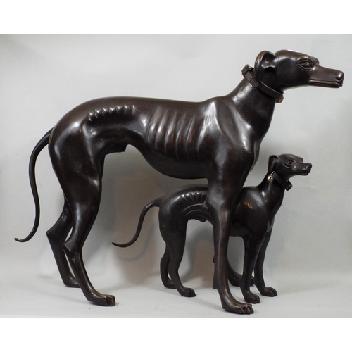 18 - Contemporary bronze figure of a whippet in standing pose and further smaller example, 48 cm in heigh...