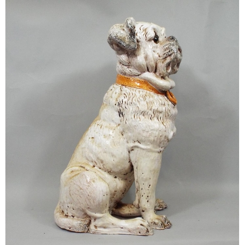 19 - Terracotta figure of a terrier with glass eyes, 43 cm in height...