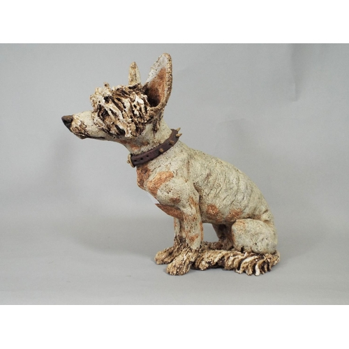 2 - A contemporary studio ware pottery figure of a recumbent hound with spiked collar monogrammed JC, 28...