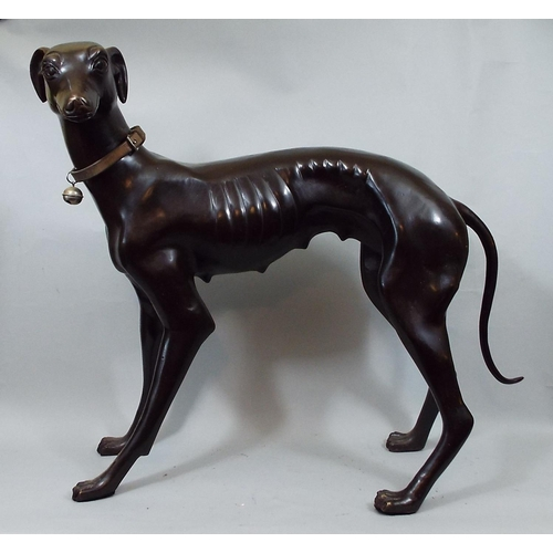 21 - Bronze figure of a standing greyhound and a further smaller example, 50 cm high...