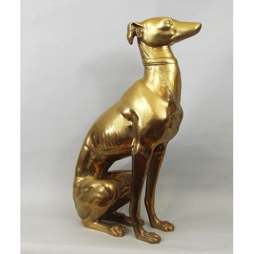 22 - A brass figure of a seated whippet, 56 cm in height...