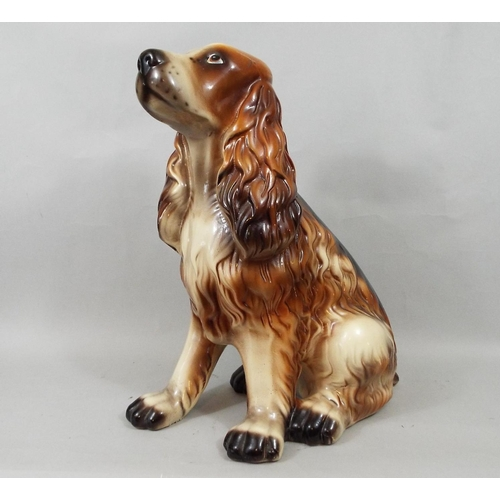 23 - Three pottery figures of spaniels, 40 cm and smaller...