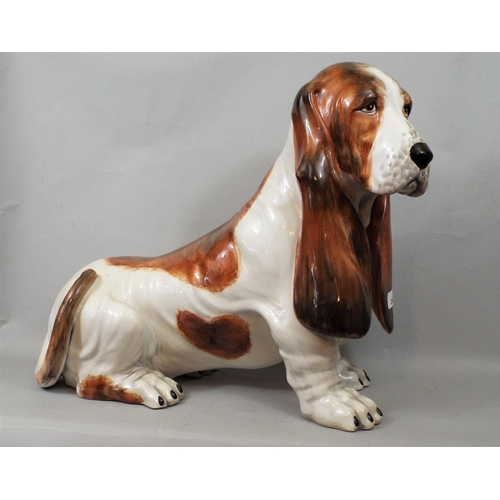 24 - Pottery figure of a basset hound, 43 cm in height...