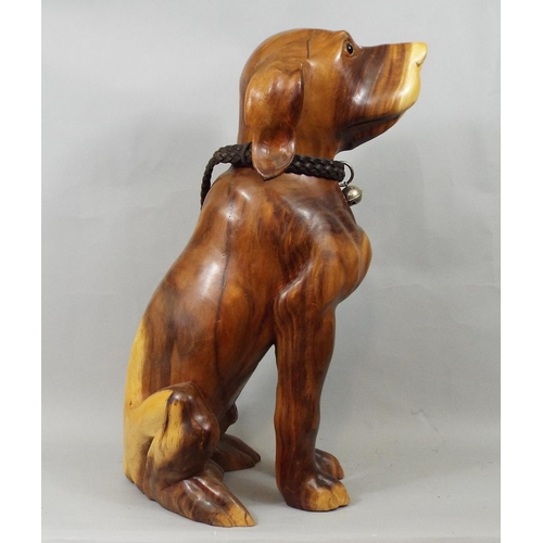 28 - A solid carved hardwood figure of a hound with plaited leather collar, 50 cm high...