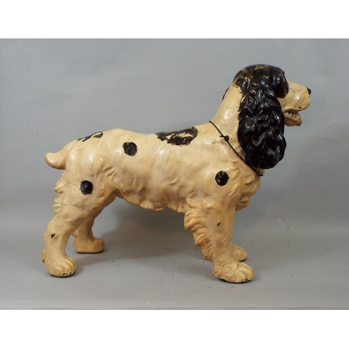 29 - A solid cast figure of a Spaniel in standing position, 36 cm in height...