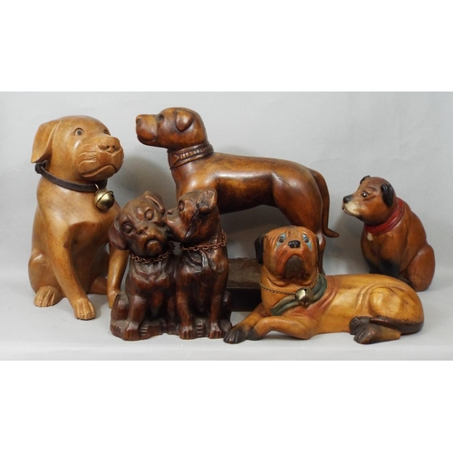 34 - Five carved timber models of dogs, 19 cm and smaller...