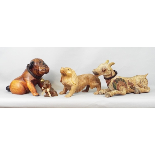 36 - Eight carved timber models of dogs including Bulldog and other breeds, 28 cm and smaller...