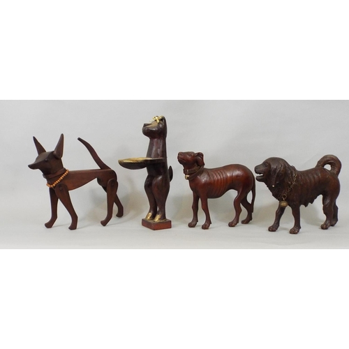 38 - Fourteen carved timber figures of dogs, various breeds, some whimsical, 32 cm and smaller...