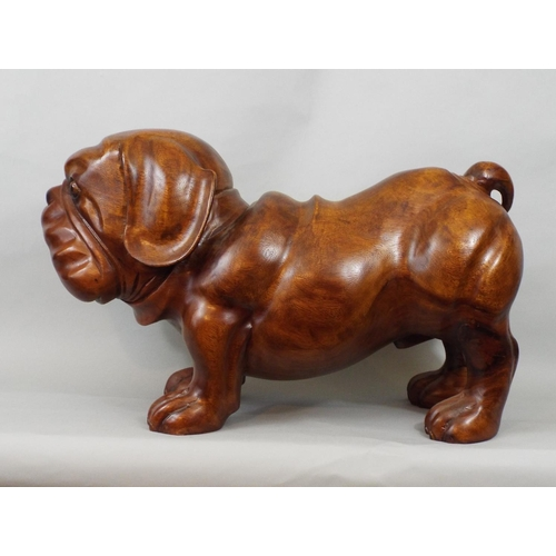 39 - Solid carved timber figure of a Bulldog, 34 cm in height...