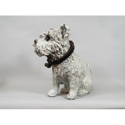 5 - A ceramic figure of a terrier with glass eyes with attached vintage leather collar, 30 cm in height...