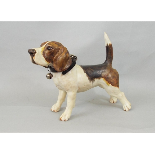 50 - A studio pottery figure of a basset hound, standing with tail erect, 24cm high...