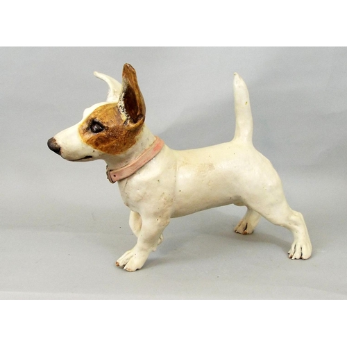 52 - A studio pottery figure of a Jack Russell terrier striding, 25cm high...