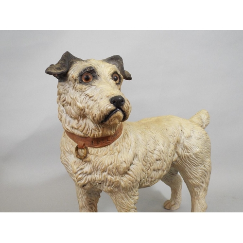 54 - A ceramic figure of a standing terrier, the collar patriotically engraved 'I belong to the king,' 27...