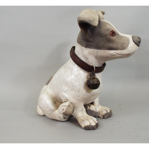 57 - A studio pottery figure of a seated terrier, 30cm high...