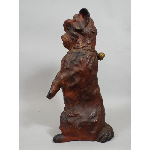 8 - 19th century pottery figure of a standing terrier, glass eyes, 31 cm in height...