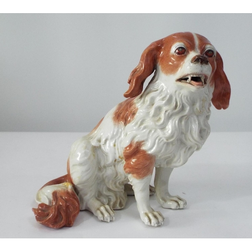 19th century Vienna porcelain model of a spaniel in a rust and white colourway with naturalistic painted details, 20cm high