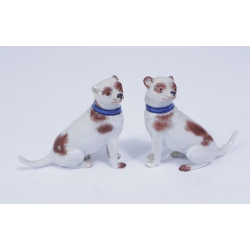 Two Meissen porcelain hounds, each with blue collars, 5 cm in height