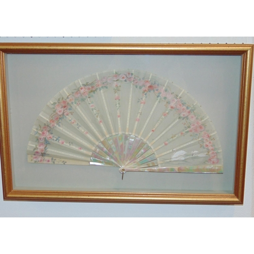 1508 - Impressive fan mounted in glazed presentation case, with mother of pearl and ivory sticks and guards...