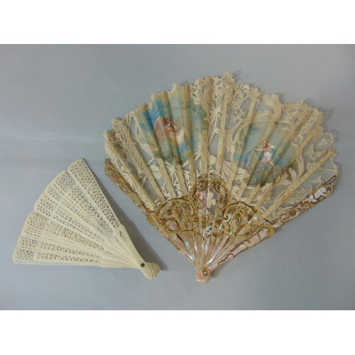 1509 - A lace leaf fan with mother of pearl guards. lace leaf with painted sections depicting a fairy and a...